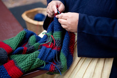 Knitting in Colonial Williamsburg (ABWphoto!) Tags: usa virginia colonialwilliamsburg outdoors knitting craft handmade afghan wool knittingneedle colorful hands closeup
