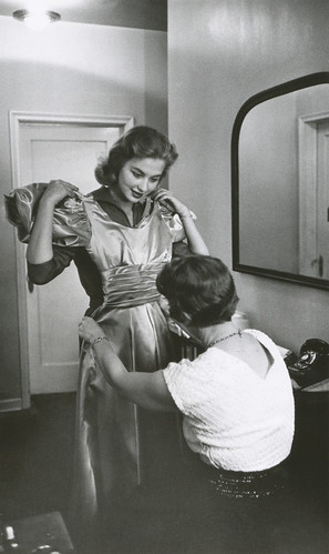 Charlotte Sheffield, the Miss USA of 1957, and her mother look over the dress which they made for Charlotte's appearance in the Miss Universe Contest at Long Beach, California