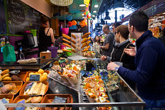 Latin taste (Miles Cave) Tags: mercat de la boqueria barcelona food color people crowd shop stall stand sell burrito fajitas papas empanadas nachos spanish latin fried fast