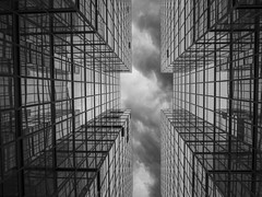 mirror mirror on the wall (Wizard CG) Tags: royal pacific hotel tsim sha tsui kowloon hong kong stacked architecture abstract looking up lookup wide angle epl7 sky glass reflection symmetry olympus blackandwhite