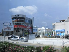 Orchestra store and Dakar Motors, Eleftherias Avenue, Larnaca, Cyprus (Paul McClure DC) Tags: larnaca larnaka cyprus mediterranean may2018 architecture modern aradippou