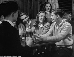 These two are going steady. Perfect match.... Before orthodontics became commonplace, dating and romance were a dicey thing. (Fotofricassee) Tags: orthodontics braces teenagers 1940s bad teeth milkshake o