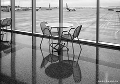 Table and Chairs, Tulsa Int. Airport (mswan777) Tags: mobile iphone iphoneography apple ansel white black monochrome concourse architecture interior indoor oklahoma tulsa travel airplane tarmac window glass chair table terminal airport