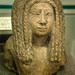 Upper part of a limestone statuette of a woman New Kingdom 18th-19th dynasty Egypt  1549-1189 BCE