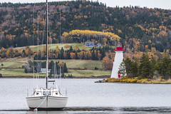 Baddeck Bay Lighthouse and Boat (fotofrysk) Tags: baddeckbay lighthouse sailboat mooring boats moorings brasdorlake fallcolour fall autumn canada novascotia capebreton scenicdrive afsnikkor200500mm56eed nikond500 20181027dng11121