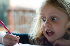 Funny girl (Janine en Ron) Tags: creative blond girl 5yearold look portrait surprise drawing couloring laughing humor