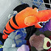 Tiger Shark in a Shark Cage with a Mass of Other Stuffed Animals