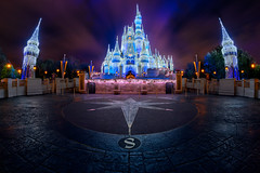 Cinderella Castle Dreamlights at Warp Speed (TheTimeTheSpace) Tags: waltdisneyworld disneyworld disney magickingdom cinderellacastle dreamlights clouds motion night nikonz7 rokinon12mm28 fisheye