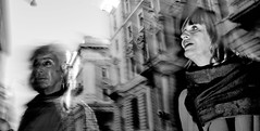 Time shift. (Baz 120) Tags: candid candidstreet candidportrait city candidface contrast street streetphotography streetphoto streetportrait strangers rome roma europe women monochrome monotone mono noiretblanc bw blackandwhite urban life portrait people italy italia omd grittystreetphotography flashstreetphotography faces decisivemoment
