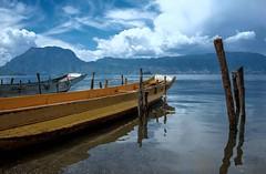 Lake Lugu Boats (Rod Waddington) Tags: china chinese yunnan lake lugu mosuo boat boats water poles landscape mountains clouds tibetan