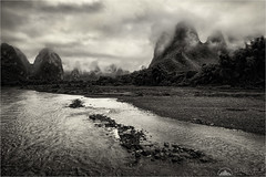 Under The Clouds (Darkelf Photography) Tags: li river china guilin yangshuo hills mountains rolling clouds moody dark mono monochrome blackandwhite sepia travel landscape canon nisi 5div 24105mm maciek gornisiewicz darkelf photography undertheclouds 2018
