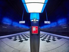 Fire hose sign (Ulrich Neitzel) Tags: bahnhof firehose fisheye hafencityuniversität hamburg metro olympusem1 red rot sign station subway tiling ubahn walimex75mm blue blau symmetry platform