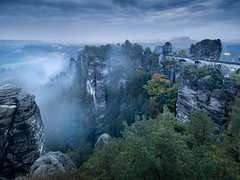 Saxony Blues (v-_-v) Tags: saxony switzerland bridge bastei fog blue clouds sunsets weather rain autumn fall rocks sandstone mountains trees germany explored