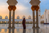 Woman-sunset-gazing-under-Grand-Mosque-archways-closeup.jpg (yobelprize) Tags: east sunsetsky yobelmuchang sheikh tourist emirates abayafashion religious united abudhabi arches zayed illuminated architecture islam worship abaya temple traditional abu redpurse dome domes sunset grand culture jedi landmark reflections mosque gold dhabi nightphotography middle islamic religion hood blue silhouette uae famous symmetry robes pillars yobel grandmosque arabic abayawoman arab muslim