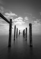 Standing firm (StuMcP) Tags: happisburgh flickr stuartmcpherson coast mono beach sea norfolk norfolkcoast ndfilter longexposure