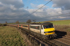 90015 Stowmarket 30/01/19 - 90015 speeds away from the camera towards the threatening skyline with 1330 London Liverpool Street to Norwich service. (rhayward92) Tags: 90015 geml class 90 stowmarket 1p32 lancasters crossing skoda greateranglia
