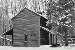 Log cabin in snow (D. C. Wilson) Tags: snow winter ice outdoor park landscape tree sky road monochrome cabin house