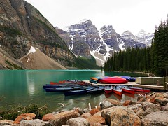 SLEEPING CANOES (Rob Patzke) Tags: mountain rock reflection alberta color canada glacier icecap lx100 lumix landscape nature outdoor panasonic pines peak rockies snow stone shoreline trees water canoe teal moraine lake park banff boulder raindrop