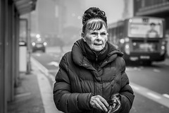 The Next Bus (Leanne Boulton) Tags: urban street candid portrait portraiture streetphotography candidstreetphotography candidportrait streetportrait streetlife old elderly woman female face eyes expression mood feeling emotion cold winter weather fog foggy isolation separation tone texture detail depthoffield bokeh naturallight outdoor light shade city scene human life living humanity society culture lifestyle people canon canon5dmkiii 70mm ef2470mmf28liiusm black white blackwhite bw mono blackandwhite monochrome glasgow scotland uk