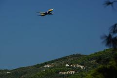 Takeoff (steve_whitmarsh) Tags: greece skiathos plane aeroplane inflight green yellow blue topic