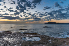 Sunrise Seascape with Clouds (Merrillie) Tags: daybreak sunrise cumulus nature dawn earlymorning coast water morning sea newsouthwales rocks pearlbeach nsw rocky waterscape ocean rockpool landscape waves coastal clouds outdoors seascape australia centralcoast sky seaside