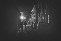 In the night (maxlaurenzi) Tags: night walking dramatic black white guastalla italy people alone silence street