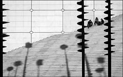 La Défense (gerhardkörsgen) Tags: atmosphere artphotography alltag blackwhite candid city la défense everyday schwarzweiss monochrome feeling france puteaux grande arche schatten shadows figures menschen gruppe people gerhardkoersgen grafic gebäude happenstance outdoor körsgen life look melancholy natural stairs treppe others perspective photographed persons streetphotography scene surreal urban view wait sit wall