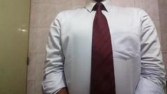 Handcuffed businessman wearing red tie (sirspankmesir) Tags: arrested shirt red tie bound man businessman handcuffed whitecollar prisoner