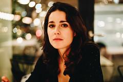 Looking back at an eventful year (dawolf-) Tags: woman girl coffee indoor lights eyes headshot portrait bar actress vienna canon night winter