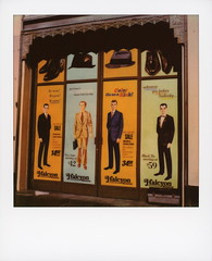 Menswear (tobysx70) Tags: polaroid originals color sx70 instant film sx70sonar menswear hollywood blvd boulevard los angeles la california ca sign poster window halcyon it's wow pow now toptotoe hat shoes suit goonacolorkick style stylish movie set dressing toby hancock photography