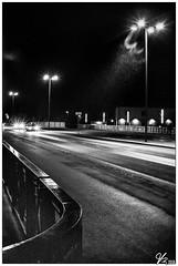 Untitled 00.84 (ViTaRu) Tags: olympus epl6 pen mzuiko m43 microfourthirds cctv fujinon25mmf14 manual lomo lomography street night nighttime nightlights nightshot streetlamps shadows contrast cars traffic bridge lofi rails rain wet winter black blackandwhite bw monochrome tuomaansilta varsinaissuomi turku finland headlights