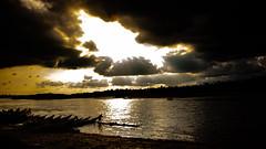 Power Of Sun (ŁoneWolf) Tags: sunset river clouds sky landscape boat boatman water sunlight tree