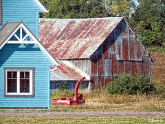 ... (Jean S..) Tags: house barn gaspésie rural grass trees red blue window old rust rusty