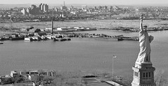 The pre-Liberty State Park shoreline with abandoned remnants of the Central Railroad of New Jersey train yards, the old Medical Center, the Journal Square PATH building and the Turnpike Extension hovering in the right background. Jersey City. March 1979. (wavz13) Tags: urbanphotography urbanphotos oldphotographs oldphotos 1970sphotographs 1970sphotos oldphotography 1970sphotography vintagephotographs vintagephotos vintagephotography filmphotos filmphotography jerseycityphotographs jerseycityphotos oldjerseycityphotography oldjerseycityphotos oldjerseycity vintagejerseycity vintagejerseycityphotography jerseycityhistory newjerseyphotographs newjerseyphotos oldnewjersey vintagenewjersey newjerseyhistory industrialjerseycity industrialruins factoryruins industrialwasteland urbanwasteland urbandecay urbanblight 1970sjerseycity vintagephoto oldphoto 1970sphoto 1970snewjersey industrialnewjersey jerseycentral centralrrofnj centralrailroadofnj centralrailroadofnewjersey wasteland industry industrial bleak bleakwasteland statueofliberty