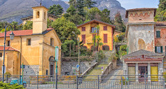St. Bartholomew's Church and Butcher Shop, Tremezzo, Lake Como (Ray in Manila) Tags: architecture beautiful church colourful eos650d green garden historic italy lake lakecomo lombardy europe placeofworship town stairs vespa scooter touristy yellow building villa como efs24mm stbartholomews butcher shop marcelleriasalumeria door roadsign fence streetlamp tremezzina