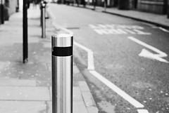 A randon post (Mister Oy) Tags: ransom post bollard om2n olympus film 35mm mono monochrome blackandwhite street