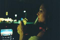 late night drive-thru (Džesika Devic) Tags: night bokeh grain cinematic green light money american bills girl frontseat passenger drive drivethru leica m6 portrait film 35mm
