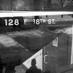 128 (kaumpphoto) Tags: rolleiflex 120 tlr ilford bw black white street urban city reflection shadow restroom minneapolis window glass snow trees blind door bathroom handle address