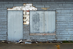 Indy#17085_Copy (Single-Tooth Productions) Tags: abandoned abandonedbuilding decay architecturaldecay architecture architecturalcomposition composition shapes colorblocks texture lines 2d flat boardup boardedupbuildingdetail doorway windowopening blue bluewall neglect bleak blight englishav indianapolis indiana urban city buildingcomposition buildingdecay urbandecay 50mm nikkor nikkor50mm nikond200 nikon