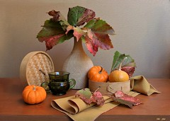 Falling Beauty (Esther Spektor - Thanks for 12+millions views..) Tags: stilllife naturemorte bodegon naturezamorta stilleben naturamorta composition creativephotography art autumn leaf food pumpkin vase box lid napkin mug glass ceramics wooden tabletop pattern texture ambientlight green orange yellow red rust beige brown estherspektor canon