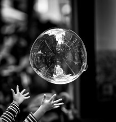 the world within your reach (gro57074@bigpond.net.au) Tags: monotone monochrome mono f14 105mmf14 artseries sigma d850 nikon bw blackwhite bubble hands candidphotography candidstreet streetphotography sydney city reaching aspiration theworldwithinyourreach guyclift nolimits reflection soapbubble child