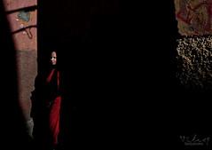 Slice o' light (Tilemachos Papadopoulos) Tags: qoq red orange people street dark fuji fujifilm fujinon light xe2 contrast candid colourful colour mirrorless shadow shade marrakech morocco kasbah mellah