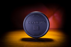 Olympus. Micro Four Thirds. MFT. (CWhatPhotos) Tags: cwhatphotos rear lens cap camera photographs photograph pics pictures pic picture image images foto fotos photography artistic that have which contain digital black micro four thirds olympus macro closeup 43 rds 43rds light shadow art round circle circular graphic bw logo vision approach view