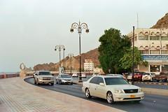 Oman 5 (Lennart Arendes) Tags: canon ae1 film analog 35mm kodak gold 200 fd 50mm oman maskat city cars traffic ocean buildings hills evening trees tree