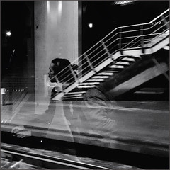 The traveler feels at home everywhere, because she is never at home anywhere. (~Ingeborg~) Tags: meinge amsterdam publictransport tram stop rietlandpark reflections monochrome night dark stairs phone 26 manwithatail hands