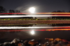 Reading outside the lines (Paul Wrights Reserved) Tags: moon light lighttrails lights night nightphotography nighttime car speed reflection reflections reflectionphotography bokeh landscape longexposure landscapes landscapephotography