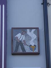 Skelton mosaic metal (Nekoglyph) Tags: skelton cleveland mosaic publicart tiles wall street pouring smelting metalwork man hat beard molten ladle white blue