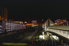 North Coast Station and the Half Moon (yarnim) Tags: moon nightsky sky halfmoon sonyrx1 rx1 carlzeiss zeiss sony 35mm train railroad traintrack northcoaststation cleveland ohio nightscape lowlight longexposure lights mood