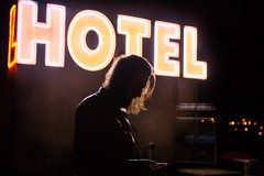 Sound of silence (Donna Mona Photographe) Tags: friendinperson fromstreetwithlove streetview street 247028 6d canon barber barbe dark night flickrexplore explore flickr 2018 longhair hair pov portrait view hotel light homme man removedfromstrobistpool nooffcameraflash seerule1