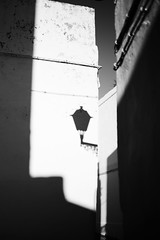 Vejer de la Frontera.. (paul.wienerroither) Tags: vejer vejerdelafrontera blackandwhite blackwhite blackandwhitephotography city light street streetphotography walking spain andalucia shadow old oldcity photography fujifilm fujifilmxt3 fujinon35mm 35mm building buildings lamp lampshade europe travel travelphotography